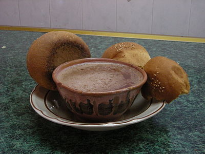 "A cup of Oaxacan-style hot chocolate served in a traditional clay mug (with no handle) and ""pan de yema"" (egg bread) Oaxacanhotchocolate.jpg"