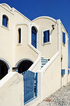 Oia, Greece - A typical white and blue painted house of Oia