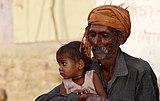 Old man with a baby girl, Morena district.jpg