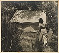 Olive Cotton by tent from Camping trips on Culburra Beach by Max Dupain and Olive Cotton (12825205573).jpg