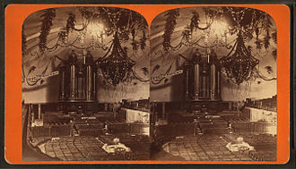 Sunday School (LDS Church) - The interior of the Salt Lake Tabernacle as decorated for the Deseret Sunday School Union's July 1875 Pioneer Day celebration.