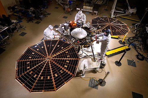 The InSight lander with solar panels deployed in a cleanroom PIA19664-MarsInSightLander-Assembly-20150430.jpg