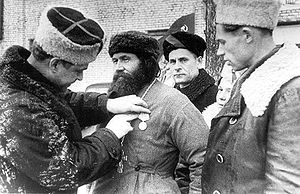 "Medal ""To a Partisan of the Patriotic War"" - A village priest being awarded the Medal ""To a Partisan of the Patriotic War"" 2nd class in Ukraine"