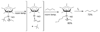 C–H activation of pentane, as seen in Ledgzdins et al., J. Am. Chem. Soc. 2007; 129, 5372–3.