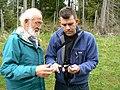 Peter instructs David on bill measuring (2460032260).jpg