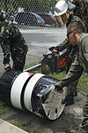 Philippine Airmen and US Marines train on aircraft crash fire rescue equipment 140506-M-UT901-099.jpg