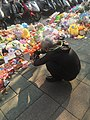 Photographer Photo Offer Items on Sidewalk 20160330.jpg