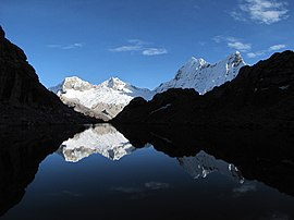 Pisco and Chacraraju reflection at Yanapaccha base camp (6020836415).jpg
