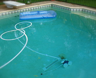 Automated pool cleaner - Below ground, outdoor pressure side automated pool cleaner visible at bottom
