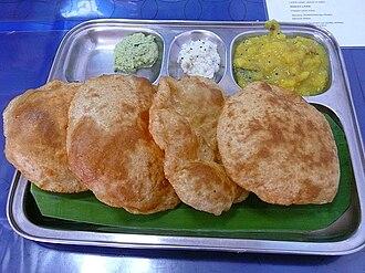 Puri (food) - Indian puri with accompaniments