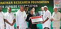Pranab Mukherjee handing over the plaque of recognition under FAO's GIAHS programme to the Chief Minister of Kerala, Shri Oommen Chandy, during the Silver Jubilee celebrations of M S Swaminathan Research Foundation (MSSRF).jpg