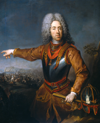 A painting of a 17th-century man wearing an armored breast plate pointing at a battlefield behind him. A sword can be seen at his hip and a helmet lies next to him.