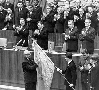 Nikolai Podgorny - Podgorny (left, bottom) conferring the Order of Lenin upon the Komsomol; Brezhnev, Kosygin and Suslov are also present