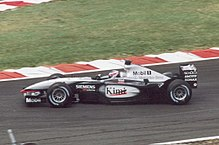 Räikkönen al volante della McLaren MP4-17D nel GP di Francia 2003