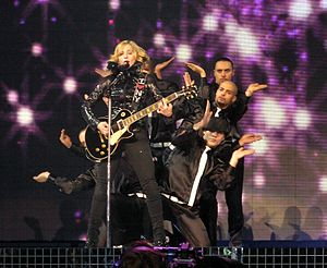 "Ray of Light (song) - Madonna, flanked by her back-up dancers, performs ""Ray of Light"" during the 2006 Confessions Tour."