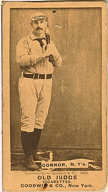 A sepia-toned baseball card of a 19th-century ballplayer holding a bat