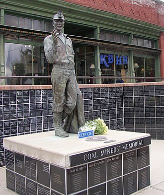 Roslyn, Washington - The Coal Miners' Memorial in Roslyn. Note the radio station film set from the Northern Exposure television series in the background.