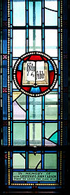Royal Military College of Canada Saint Raphael's Roman Catholic Chapel memorial window to John Carson Emblem Bible and Torch.jpg
