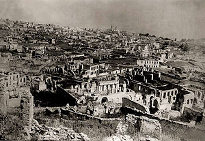Shusha massacre - Ruins of Armenian part of Shusha after the 1920 pogrom. On the background - Armenian church of the Holy Mother of God (Kanach Zham).