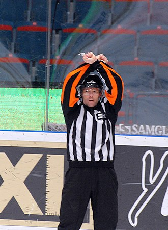 Penalty shot (ice hockey) - A referee giving the signal for a penalty shot.
