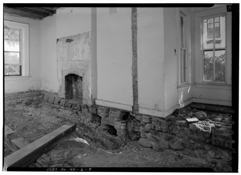 File southeast room with a fireplace and a foundation for Ramsey fireplace