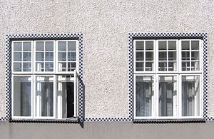 Sanatorium Purkersdorf - View of the windows with tile detailing.