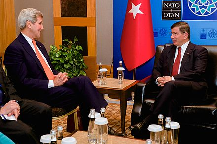 Prime Minister Ahmet Davutoglu meets with US Secretary of State John Kerry during a NATO ministerial meeting in Antalya, 13 May 2015 Secretary Kerry Meets With Turkish Prime Minister Ahmet Davutoglu - 17406847529.jpg