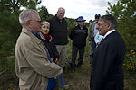 Secretary of Defense Leon E. Panetta, right, speaks with family members of passengers aboard United Airlines Flight 93 during a 9-11 commemoration event Sept 120910-D-TT977-259.jpg