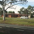 Shiny White Car of Australia and Red Brick with Eucalyptus.jpg