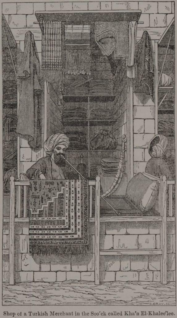 Shop of a Turkish Merchant in the Soo'ck called Kha'n El-Khalee'lee. (1836) - TIMEA