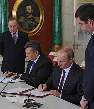 17 December 2013 Ukrainian–Russian action plan - Russian President Putin and Ukrainian President Yanukovych signing a joint bilateral programme of celebrations for the 200th anniversary of the birth of Taras Shevchenko in 2014 on 17 December 2013