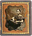 Sixth plate tintype of a young woman posed with a rocking melodeon (circa late-1850s), Found in New Hampshire.jpg