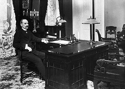 K. J. Ståhlberg (1865–1952), the first President of the Republic of Finland, defined Finland's anchoring as a country defending liberal democracy.[14] Ståhlberg at his office in 1919.
