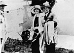 StateLibQld 2 167367 Honeymooners boarding a plane at Winton, 1920 - 1930.jpg