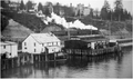Steam locomotive and warehouses on the shore of New Westminster, BC.png