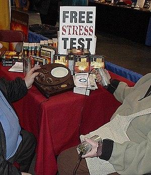 Scientologist demonstrating the e-meter as par...