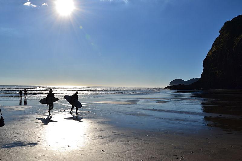 File:Surfers at Piha Beach (7187483494).jpg