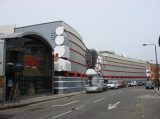 Breakfast Television Centre - Former TV-am studios in Camden Lock. The TV-am lettering down the side of the fascia covered with discs in 1993.