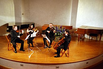 String quartet - A string quartet in performance. From left to right – violin 1, violin 2, viola, cello