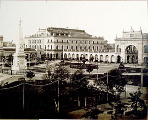 Teatro Colón - The first theatre (left), in front of Plaza de Mayo in 1881, photo by Alexander Witcomb.