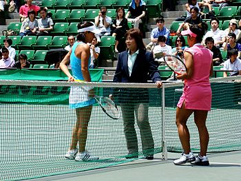 English: An umpire informing Kimiko Date and a...