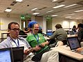 Testing and hacking wikimaps at the hackathon.JPG