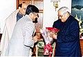 The Minister for Information and Broadcasting Shri Ravi Shankar Prasad greeting the Prime Minister Shri Atal Bihari Vajpayee on ' Happy New Year' in New Delhi on January 1, 2004.jpg