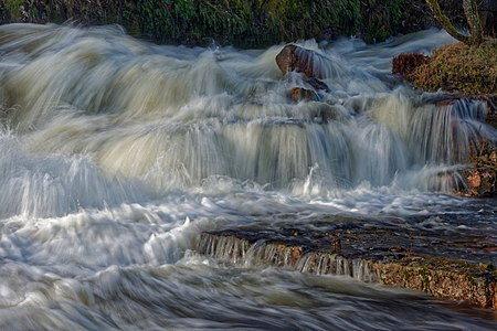 The rapids of Borgviksälven running through the old iron works in Borgvik, Sweden.