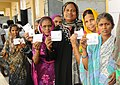 The voters showing their voter identity cards, at a polling booth, during the Tamil Nadu Assembly Election, in Kanchipuram on May 16, 2016.jpg