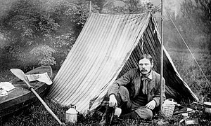 Camping - Thomas Hiram Holding outside his camping tent.