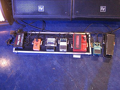 A photo of Morello's Audioslave era pedal board; on the far left is a Voodoo Lab Pedal Power 2 Plus Tom Pedalboard.jpg