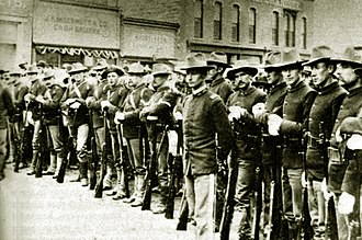 Rock Springs massacre - Federal soldiers on South Front Street in Rock Springs, 1885. Troops were first deployed in Rock Springs to quell the riot on September 5.