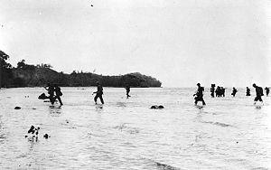 Battle of Tulagi and Gavutu–Tanambogo - United States Marines wade ashore on Tulagi Island on 7 August 1942.