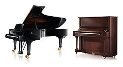 Two pianos - grand piano and upright piano.jpg